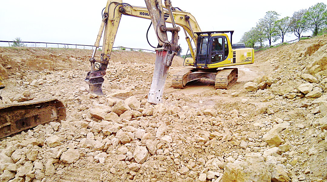 Kucie skały przez koparki